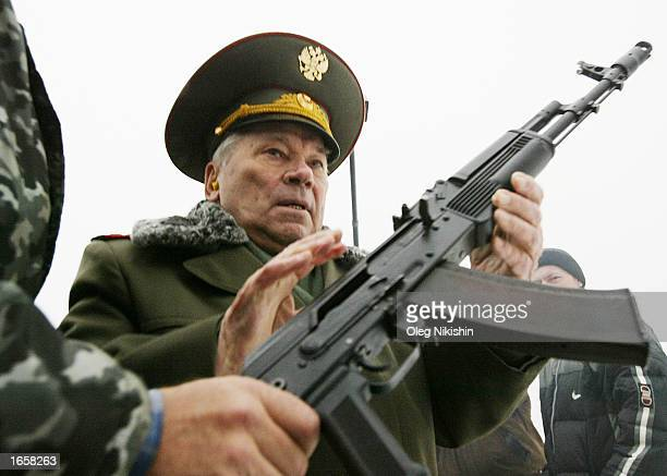 Mikhail Kalashnikov the father of the world's most popular assault rifle is handed an AK74 November 23 2002 in Izhevsk1000 East km from Moscow...