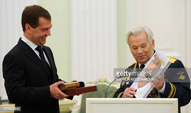 Mikhail Kalashnikov the Russian inventor of the globally popular AK47 assault rifle presents Russian President Dmitry Medvedev with a copy of a book...