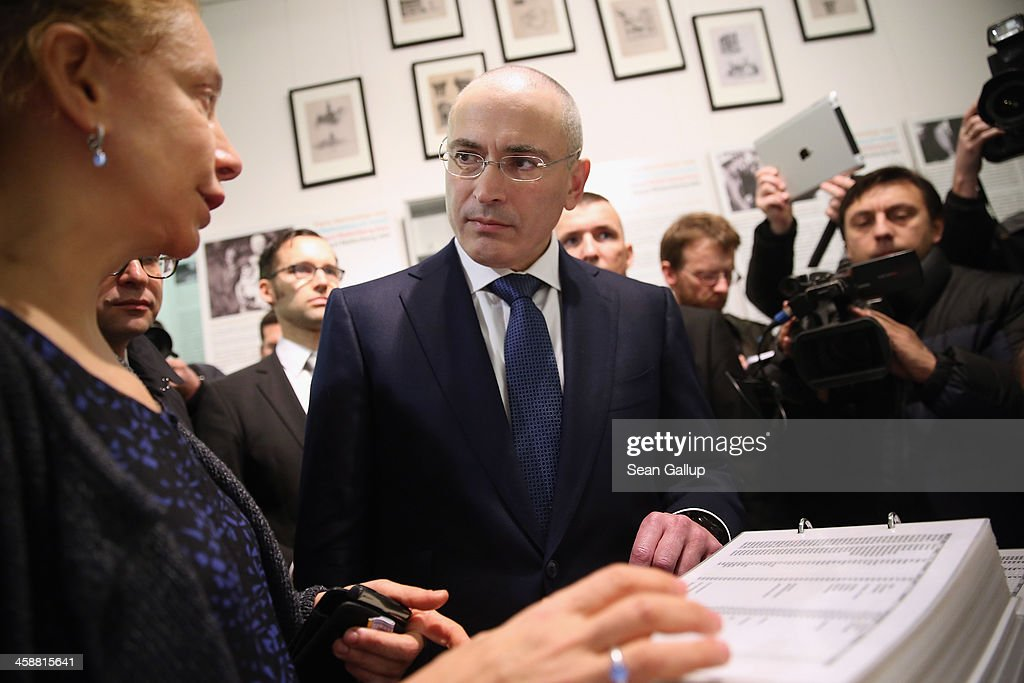 <a gi-track='captionPersonalityLinkClicked' href=/galleries/search?phrase=Mikhail+Khodorkovsky&family=editorial&specificpeople=224938 ng-click='$event.stopPropagation()'>Mikhail Khodorkovsky</a>, the former Yukos oil company chairman who was charged with embezzlement and tax evasion, tours the Mauer-Museum am Checkpoint Charlie museum with museum director Alexandra Hildebrandt (L) prior to his first press conference since his release from a Russian prison two days before on December 22, 2013 in Berlin, Germany. Khodorkovsky flew to Berlin and was received by former German Foreign Minister Hans-Dietrich Genscher and has also been reunited with his family. Khodorkovsky spent 10 years in prison until his unexpected pardon by Russian President Vladimir Putin.