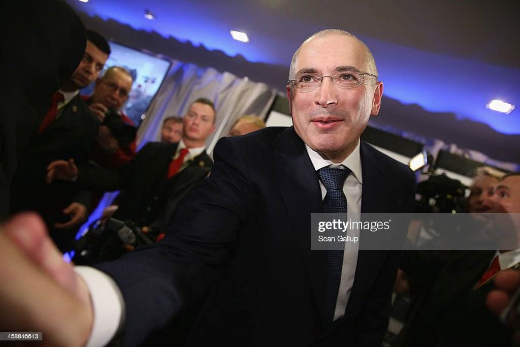 <a gi-track='captionPersonalityLinkClicked' href=/galleries/search?phrase=Mikhail+Khodorkovsky&family=editorial&specificpeople=224938 ng-click='$event.stopPropagation()'>Mikhail Khodorkovsky</a>, the former Yukos oil company chairman who was charged with embezzlement and tax evasion, greets a well-wisher after he spoke to the media at his first press conference since his release from a Russian prison two days before on December 22, 2013 in Berlin, Germany. Khodorkovsky flew to Berlin and was received by former German Foreign Minister Hans-Dietrich Genscher and has also been reunited with his family. Khodorkovsky spent 10 years in prison until his unexpected pardon by Russian President Vladimir Putin.