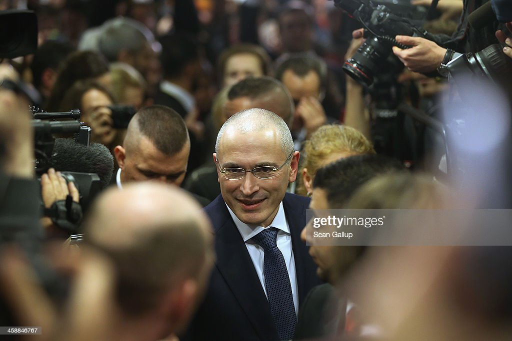 <a gi-track='captionPersonalityLinkClicked' href=/galleries/search?phrase=Mikhail+Khodorkovsky&family=editorial&specificpeople=224938 ng-click='$event.stopPropagation()'>Mikhail Khodorkovsky</a>, the former Yukos oil company chairman who was charged with embezzlement and tax evasion, arrives to speak to the media at his first press conference since his release from a Russian prison two days before on December 22, 2013 in Berlin, Germany. Khodorkovsky flew to Berlin and was received by former German Foreign Minister Hans-Dietrich Genscher and has also been reunited with his family. Khodorkovsky spent 10 years in prison until his unexpected pardon by Russian President Vladimir Putin.