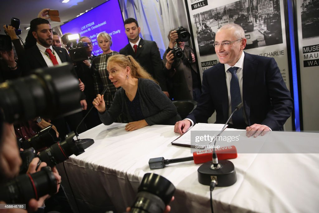 <a gi-track='captionPersonalityLinkClicked' href=/galleries/search?phrase=Mikhail+Khodorkovsky&family=editorial&specificpeople=224938 ng-click='$event.stopPropagation()'>Mikhail Khodorkovsky</a> (R), the former Yukos oil company chairman who was charged with embezzlement and tax evasion, arrives to speak to the media at his first press conference since his release from a Russian prison two days before on December 22, 2013 in Berlin, Germany. Khodorkovsky flew to Berlin and was received by former German Foreign Minister Hans-Dietrich Genscher and has also been reunited with his family. Khodorkovsky spent 10 years in prison until his unexpected pardon by Russian President Vladimir Putin.