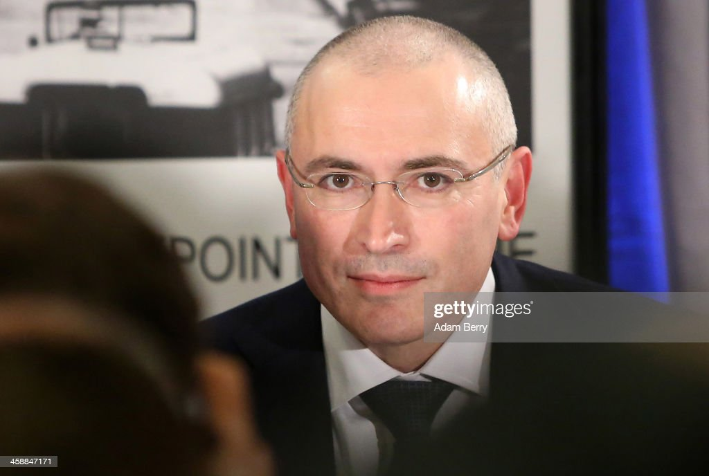 <a gi-track='captionPersonalityLinkClicked' href=/galleries/search?phrase=Mikhail+Khodorkovsky&family=editorial&specificpeople=224938 ng-click='$event.stopPropagation()'>Mikhail Khodorkovsky</a>, the former Yukos oil company chairman who was charged with embezzlement and tax evasion, arrives for his first press conference since his release from a Russian prison two days before on December 22, 2013 in Berlin, Germany. Khodorkovsky flew to Berlin and was received by former German Foreign Minister Hans-Dietrich Genscher and has also been reunited with his family. Khodorkovsky spent 10 years in prison until his unexpected pardon by Russian President Vladimir Putin.