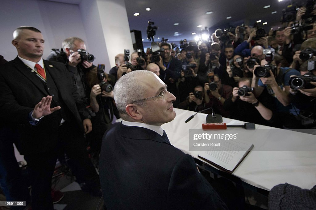 <a gi-track='captionPersonalityLinkClicked' href=/galleries/search?phrase=Mikhail+Khodorkovsky&family=editorial&specificpeople=224938 ng-click='$event.stopPropagation()'>Mikhail Khodorkovsky</a>, the former Yukos oil company chairman who was charged with embezzlement and tax evasion, arrives at his first press conference since his release from a Russian prison two days before on December 22, 2013 in Berlin, Germany. Khodorkovsky flew to Berlin and was received by former German Foreign Minister Hans-Dietrich Genscher and has also been reunited with his family. Khodorkovsky spent 10 years in prison until his unexpected pardon by Russian President Vladimir Putin.
