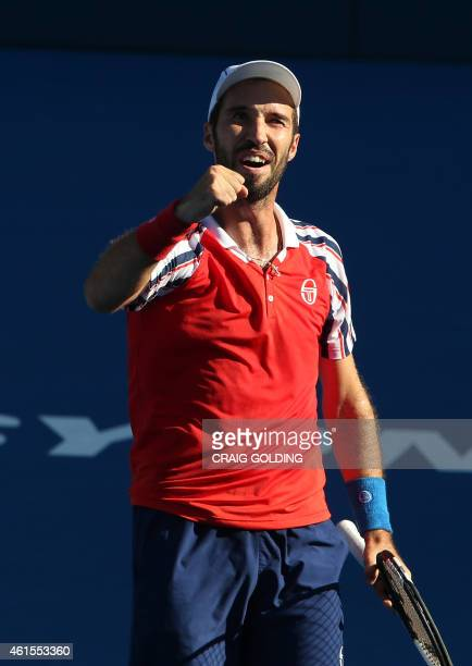 Mikhail Kukushkin of Kazakhstan celebrates his win over Juan Martin Del Potro of Argentina during their men's singles match on day five of the Sydney...