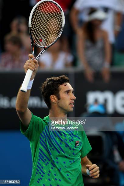 Mikhail Kukushkin of Kazakhstan celebrates winning his third round match against Gael Monfils of France during day six of the 2012 Australian Open at...