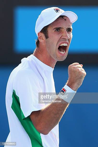 Mikhail Kukushkin of Kazakhstan celebrates winning the second set in his third round match against Gael Monfils of France during day six of the 2012...