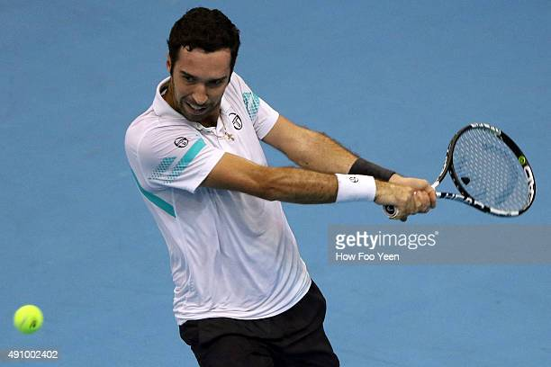 Mikhail Kukushkin of Kazakhstan competes against David Ferrer of Spain during the 2015 ATP Malaysian Open at Bukit Jalil National Stadium on October...