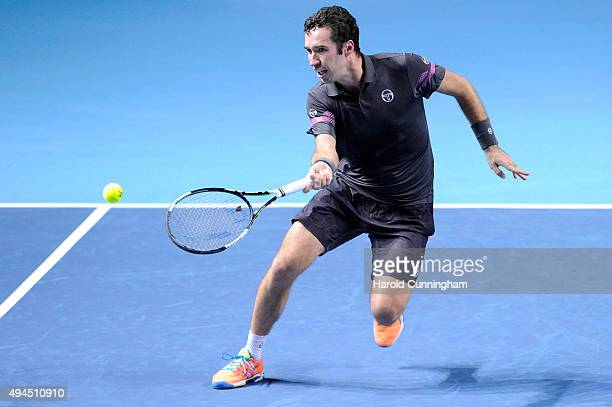 Mikhail Kukushkin of Kazakhstan in action during the second day of the Swiss Indoors ATP 500 tennis tournament for his match against Roger Federer of...