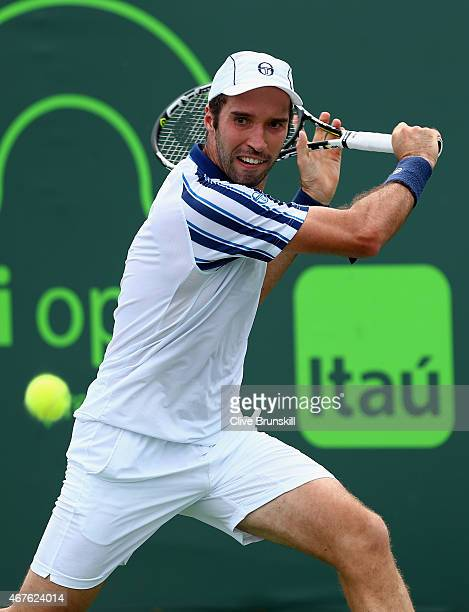 Mikhail Kukushkin of Kazakhstan plays a backhand against Steve Johnson of the United States in their first round match during the Miami Open at...