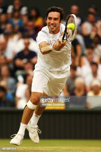 Mikhail Kukushkin of Kazakhstan plays a backhand return during his Gentlemen's Singles third round match against Rafael Nadal of Spain on day six of...