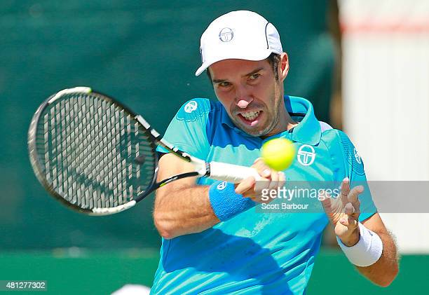 Mikhail Kukushkin of Kazakhstan plays a forehand during the reverse singles match between Sam Groth of Australia and Mikhail Kukushkin of Kazakhstan...