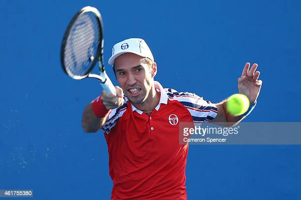 Mikhail Kukushkin of Kazakhstan plays a forehand in his first round match against Malek Jaziri of Tunisia during day one of the 2015 Australian Open...