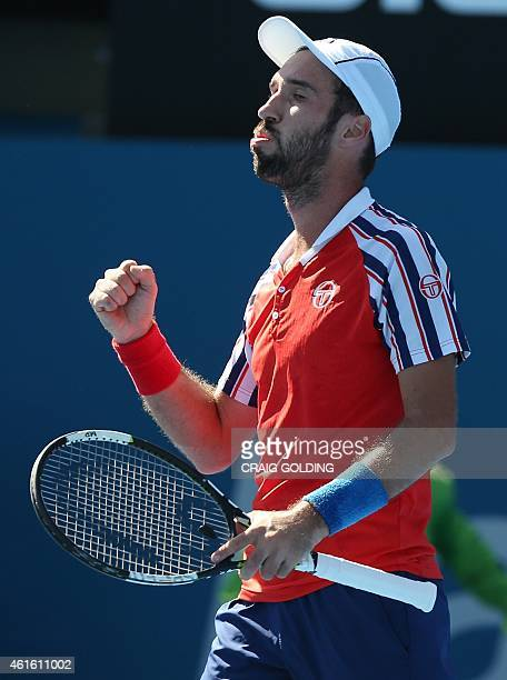 Mikhail Kukushkin of Kazakhstan reacts after winning a game against Leonardo Mayer of Argentina during their men's singles semi final match on day...