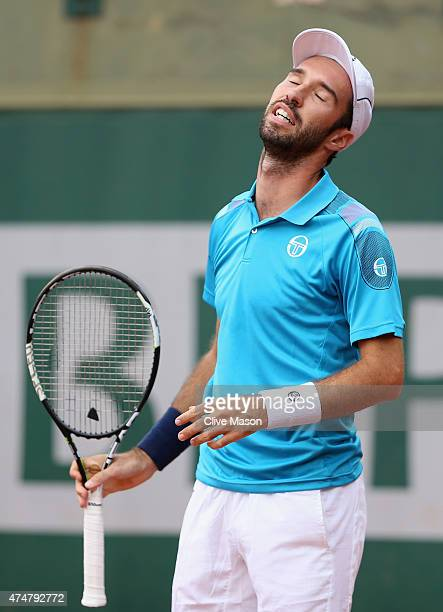 Mikhail Kukushkin of Kazakhstan reacts next to his partner Johan Brunstrom of Sweden during their men's doubles match against Andrey Golubev of...