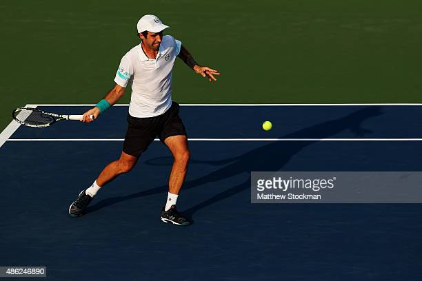 Mikhail Kukushkin of Kazakhstan returns a shot against Grigor Dimitrov of Bulgaria during their Men's Singles Second Round match on Day Three of the...