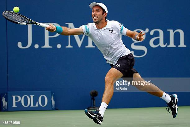 Mikhail Kukushkin of Kazakhstan returns a shot against Marin Cilic of Croatia during their Men's Singles Third Round match on Day Five of the 2015 US...