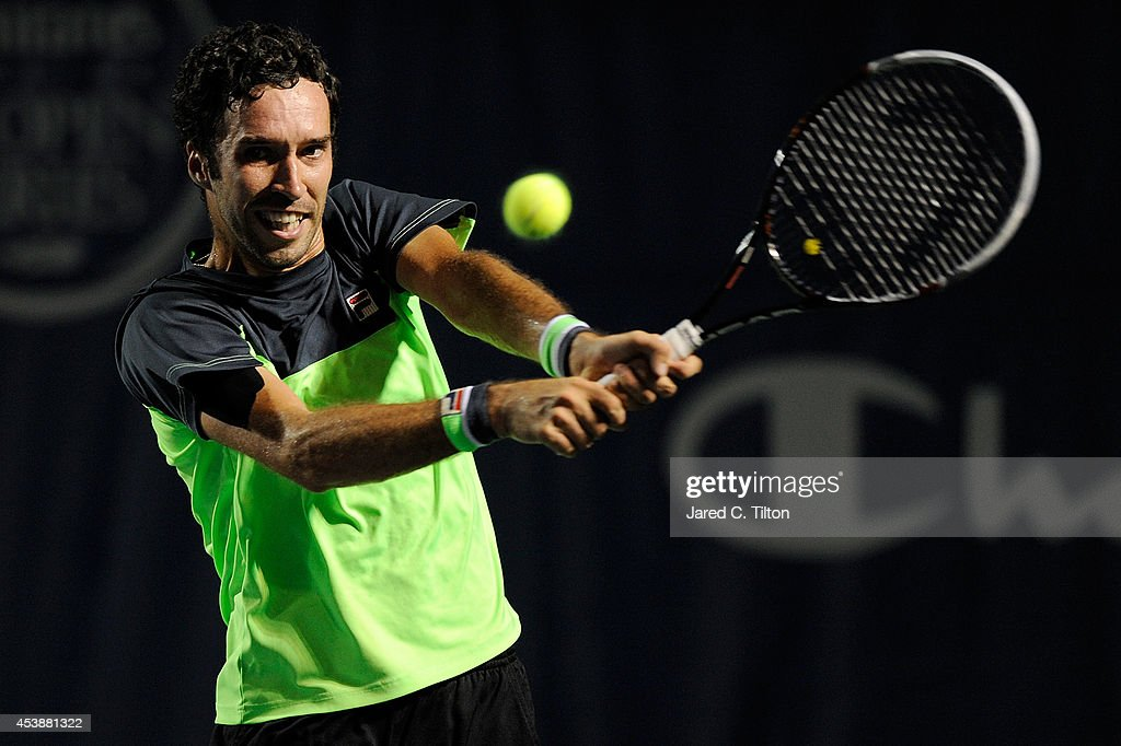 <a gi-track='captionPersonalityLinkClicked' href=/galleries/search?phrase=Mikhail+Kukushkin&family=editorial&specificpeople=5304335 ng-click='$event.stopPropagation()'>Mikhail Kukushkin</a> of Kazakhstan returns a shot from John Isner during the Winston-Salem Open at Wake Forest University on August 20, 2014 in Winston Salem, North Carolina.