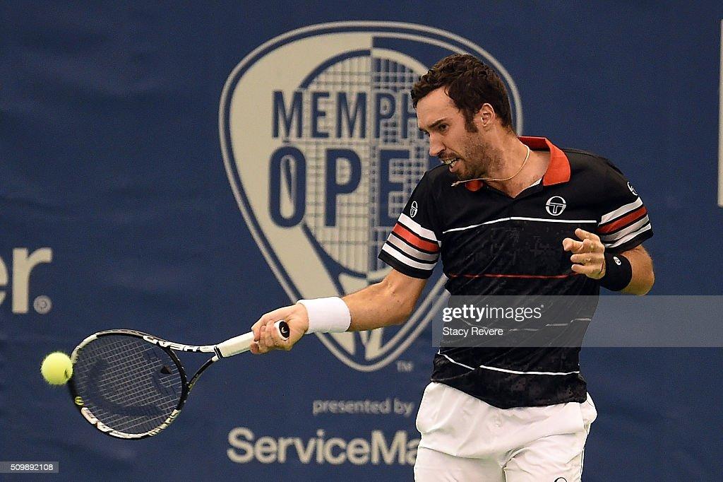 Mikhail Kukushkin of Kazakhstan returns a shot to Kei Nishikori of Japan during their quarterfinal singles match on Day 5 of the Memphis Open at the...