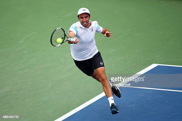 Mikhail Kukushkin of Kazakhstan returns a shot to Marin Cilic of Croatia during their Men's Singles Third Round match on Day Five of the 2015 US Open...