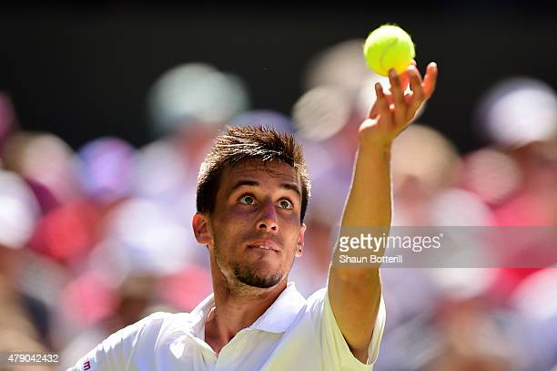 Mikhail Kukushkin of Kazakhstan serves in his Gentlemen's Singles first round match against Andy Murray of Great Britain during day two of the...