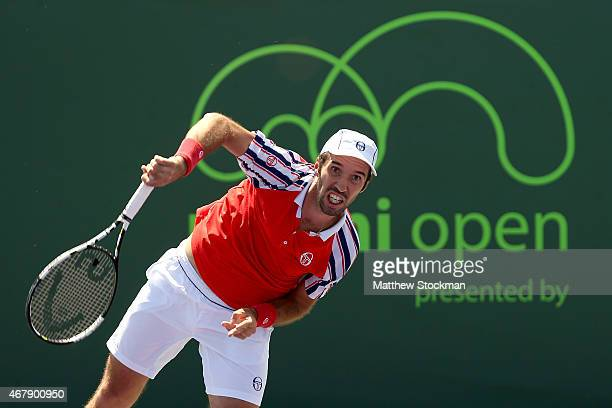 Mikhail Kukushkin of Kazakhstan serves to Gilles Simon of France during day 5 of the Miami Open Presented by Itau at Crandon Park Tennis Center on...