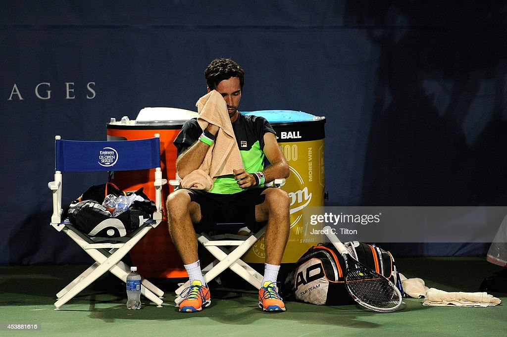 Mikhail Kukuskin of Kazakhstan rests between side change during his matich with John Isner during the Winston-Salem Open at Wake Forest University on August 20, 2014 in Winston Salem, North Carolina.