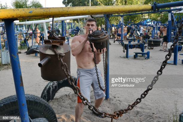 Mikhail lifts weights on August 18 2017 at an open air gym in Ukraine's capital Kiev Foundedin the 1970s the busy open air gym called Kachalka in...