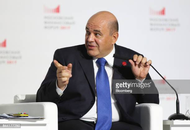 Mikhail Mishustin head of Russia's federal tax service gestures as he speaks during a panel session at the Moscow Financial Forum in Moscow Russia on...