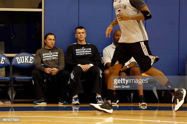 Mikhail Prokhorov owner of the Brooklyn Nets sits on the bench and looks on at Duke University for a preseason training camp on September 30 2015 in...