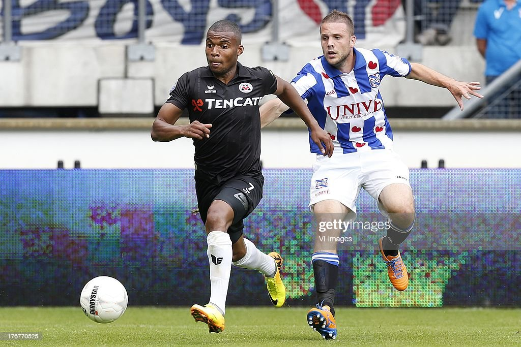 Mikhail Rosheuvel of Heracles Almelo (L), Samir Fazli of SC Heerenveen (R) during the Dutch Eredivisie match between sc Heerenveen and Heracles Almelo on August 18, 2013 at the Abe Lenstra stadium in Heerenveen, The Netherlands.