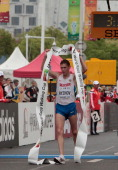 Mikhail Ryzhov of Russia crosses the finish line as he wins the men's 50 Km race at the IAAF World Race Walking Cup on May 3 2014 in Taicang China
