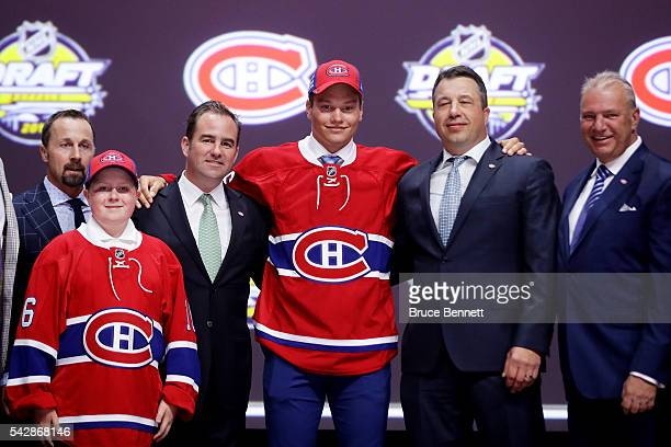 Mikhail Sergachev celebrates with the Montreal Canadiens after being selected ninth overall during round one of the 2016 NHL Draft on June 24 2016 in...