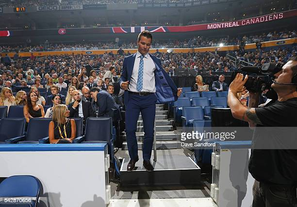 Mikhail Sergachev makes his way to the stage after being selected ninth overall by the Montreal Canadiens during round one of the 2016 NHL Draft at...