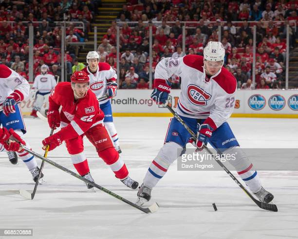 Mikhail Sergachev of the Montreal Canadiens controls the puck in front of Matt Lorito of the Detroit Red Wings during an NHL game at Joe Louis Arena...