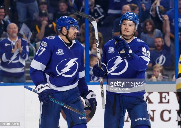 Mikhail Sergachev of the Tampa Bay Lightning celebrates a goal with teammate Alex Killorn against the Pittsburgh Penguins during the third period at...