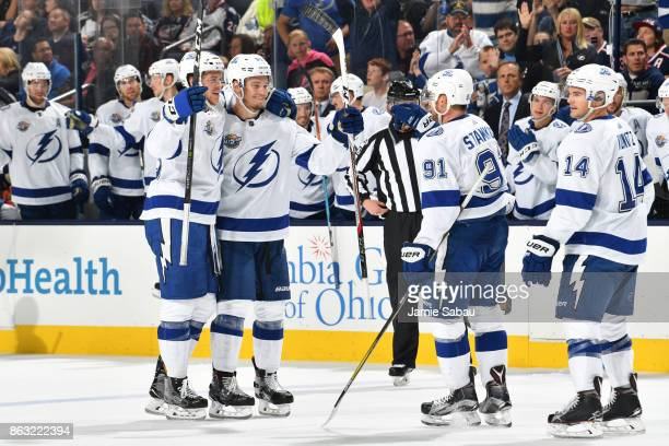 Mikhail Sergachev of the Tampa Bay Lightning celebrates his second period goal with his fellow teammates during a game against the Columbus Blue...