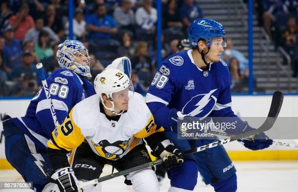 Mikhail Sergachev of the Tampa Bay Lightning skates against Jake Guentzel of the Pittsburgh Penguins during the second period at Amalie Arena on...
