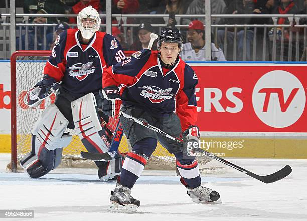 Mikhail Sergachev of the Windsor Spitfires defends against the London Knights during an OHL game at Budweiser Gardens on October 30 2015 in London...