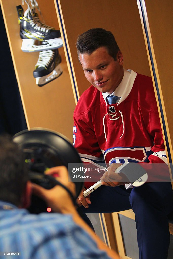 Mikhail Sergachev poses for a photographer after being selected ninth overall by the Montreal Canadiens during round one of the 2016 NHL Draft at First Niagara Center on June 24, 2016 in Buffalo, New York.