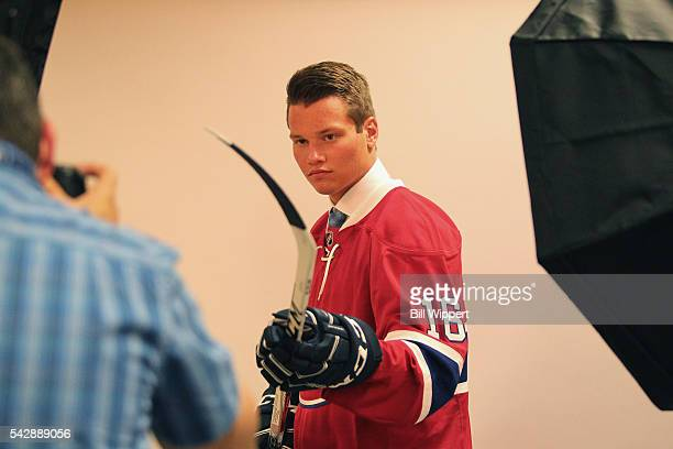 Mikhail Sergachev poses for a photographer after being selected ninth overall by the Montreal Canadiens during round one of the 2016 NHL Draft at...