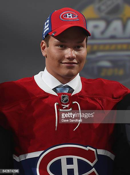 Mikhail Sergachev smiles onstage after being selected ninth overall by the Montreal Canadiens during round one of the 2016 NHL Draft at First Niagara...