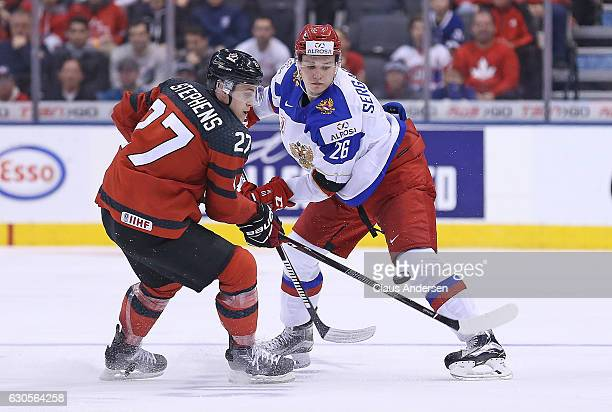 Mikhail Sergachyov of Team Russia skates against Mitchell Stephens of Team Canada during a game at the the 2017 IIHF World Junior Hockey...