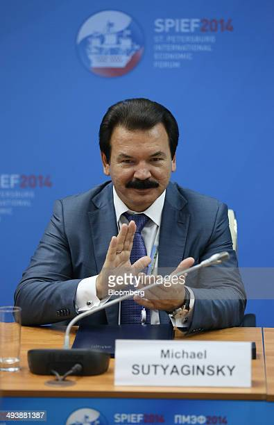 Mikhail Sutyaginsky chairman of CJSC GC Titan applauds during a session at the St Petersburg International Economic Forum in Saint Petersburg Russia...