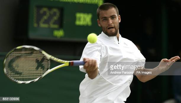 Mikhail Youzhny in action againt Rafael Nadal during The All England Lawn Tennis Championship at Wimbledon