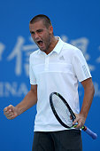 Mikhail Youzhny of Russia celebrates a ball against Viktor Troicki of Serbia during day three of the China Open at the China National Tennis Center...