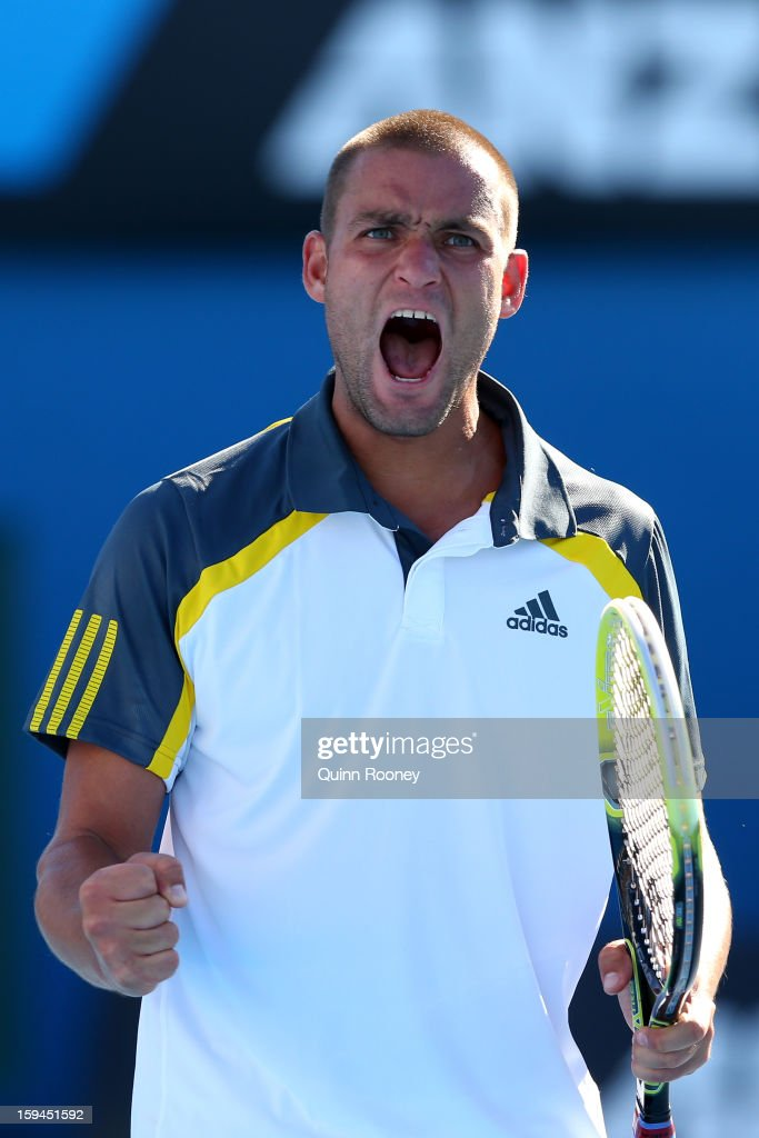 <a gi-track='captionPersonalityLinkClicked' href=/galleries/search?phrase=Mikhail+Youzhny&family=editorial&specificpeople=171709 ng-click='$event.stopPropagation()'>Mikhail Youzhny</a> of Russia celebrates a point in his first round match against Matthew Ebden of Australia during day one of the 2013 Australian Open at Melbourne Park on January 14, 2013 in Melbourne, Australia.