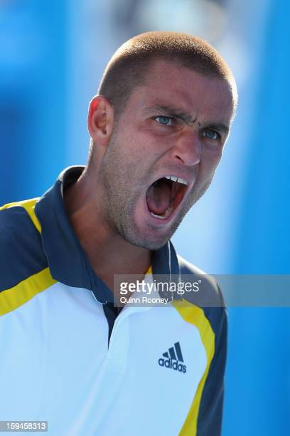 Mikhail Youzhny of Russia celebrates a point in his first round match against Matthew Ebden of Australia during day one of the 2013 Australian Open...