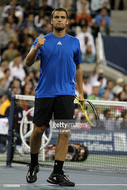 Mikhail Youzhny of Russia celebrates after he won his men's singles match against John Isner of the United States on day seven of the 2010 US Open at...
