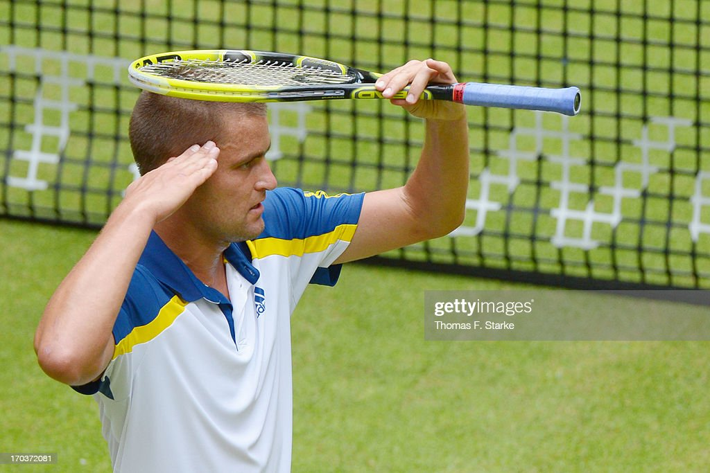 <a gi-track='captionPersonalityLinkClicked' href=/galleries/search?phrase=Mikhail+Youzhny&family=editorial&specificpeople=171709 ng-click='$event.stopPropagation()'>Mikhail Youzhny</a> of Russia celebrates after winning his match against Kei Nishikori of Japan during day three of the Gerry Weber Open at Gerry Weber Stadium on June 12, 2013 in Halle, Germany.